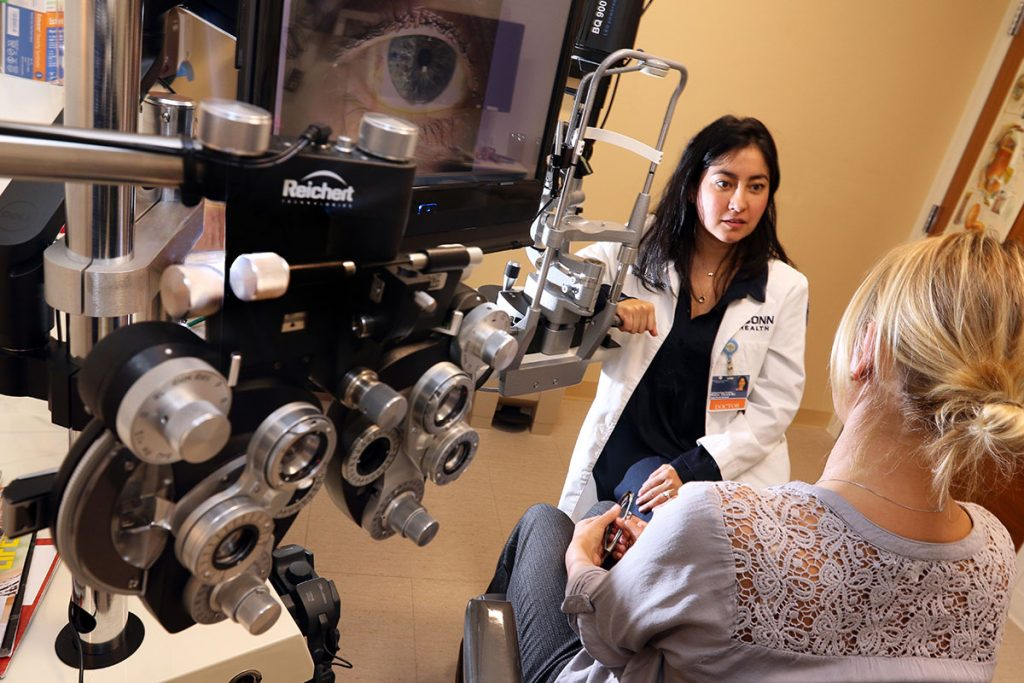 Dr. Falcone with equipment in eye exam room