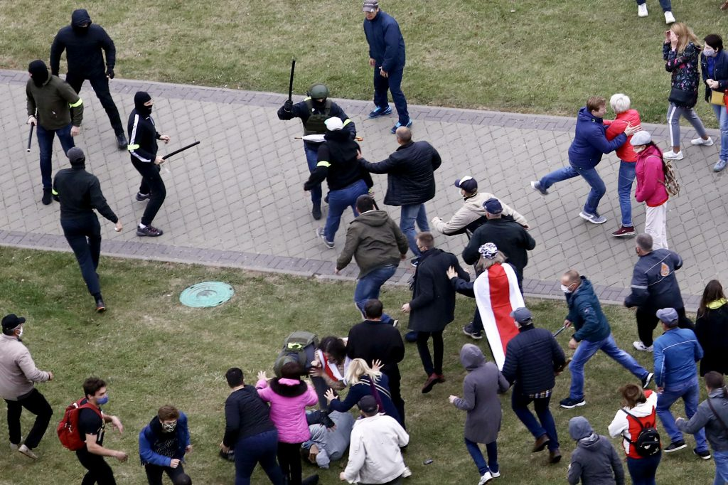 Police with batons attack pro-democracy demonstrators in Belarus.