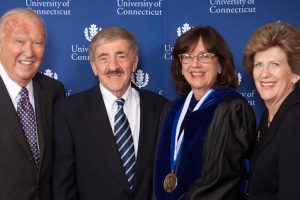 Ray Neag '56 (CLAS), Professors Joseph Renzulli and Sally Reis, and Carole Neag (l-r) gather after the Letitia Neag Morgan Chair in Educational Psychology Investiture for Reis in 2011.