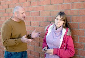 A man remonstrates with his daughter about his perceptions regarding her weight