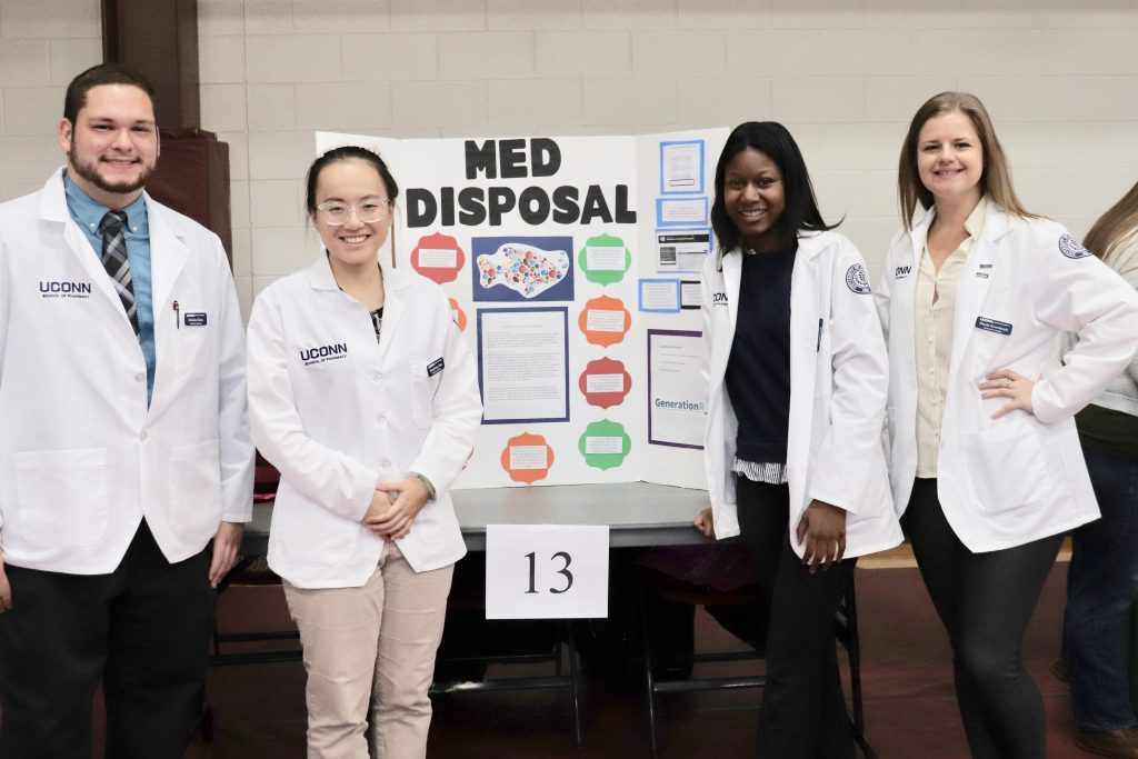 School of Pharmacy students provide information on medication disposal at a community event for seniors in 2019