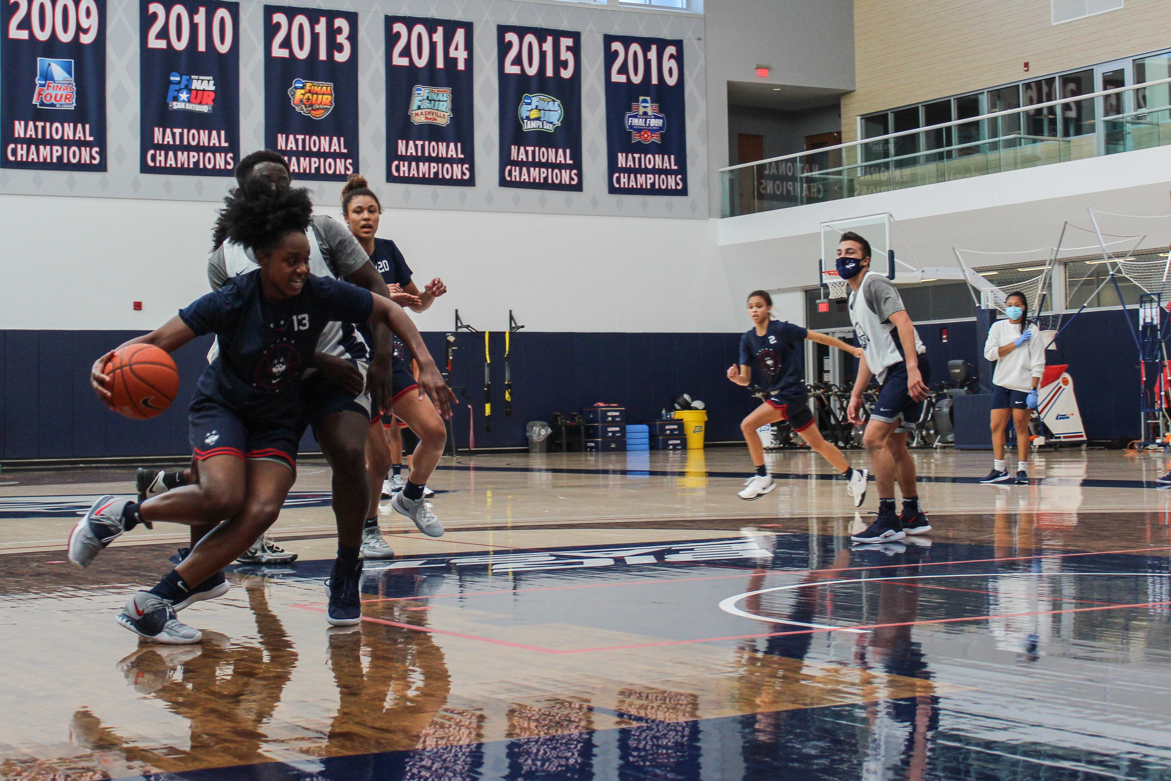 The UConn women's basketball team practicing ahead of the start of their season, which was delayed by the pandemic.