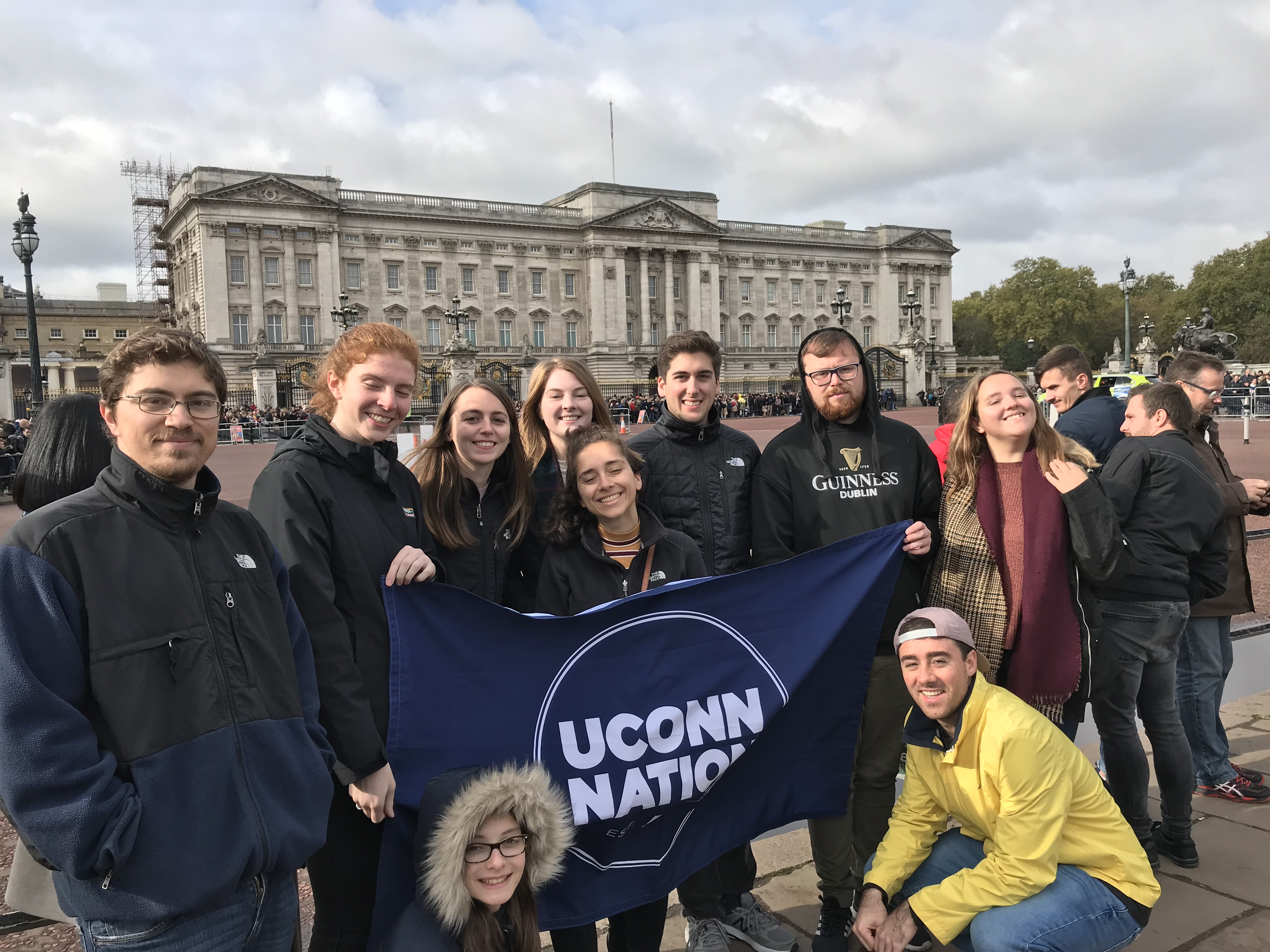 College students gather in front of Buckingham Palace in London.