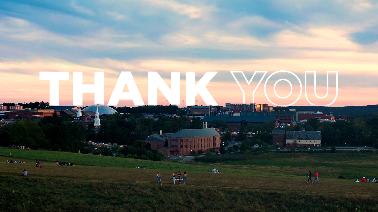 The word thank you sprawled out across horsebarn hill at sunset