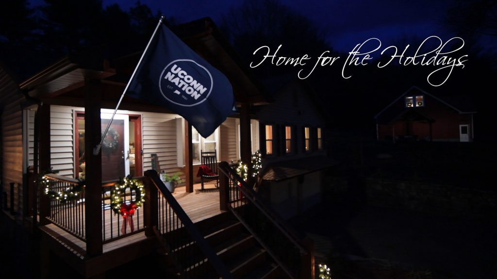 Photo of a house with a UConn Nation flag flying