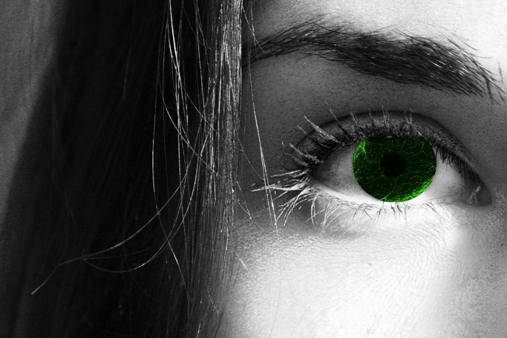 Women's face (black and white) with color image of cornea