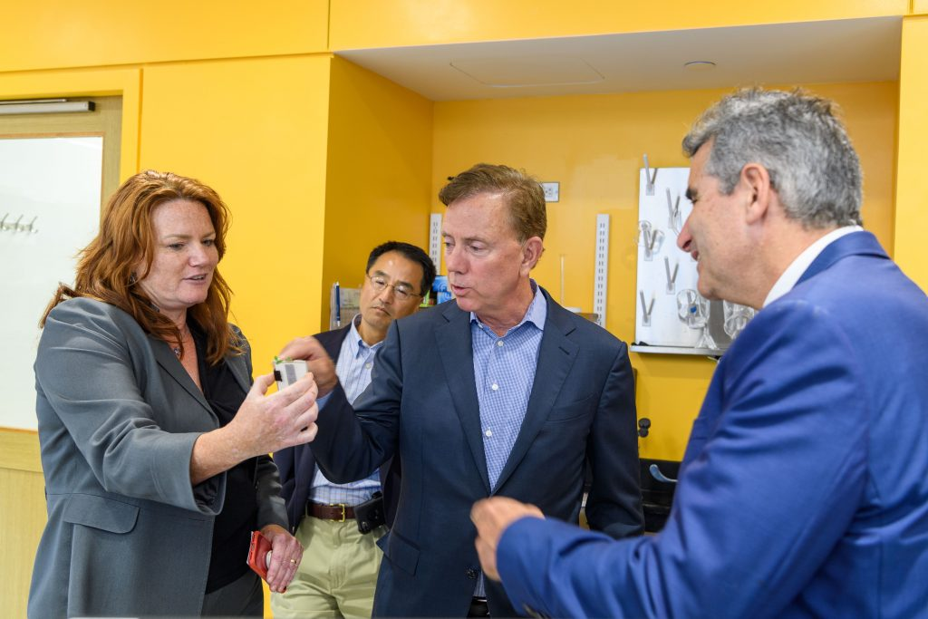Professor Ki Chon, second from left, and President Thomas Katsouleas, far right, with Gov. Ned Lamont and Leslie Shor, associate dean for research, during a tour at the Engineering Science Building on Sept. 4, 2019