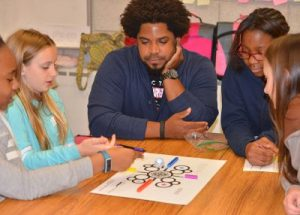 Dwight Sharpe works with middle school students.