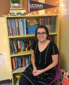 Jessica Stargardter sits in front of book shelf.