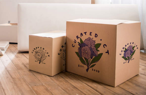 Two boxes ready to ship, featuring the Curated CT logo