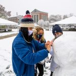 ... even masks while building a snowman, after an unseasonal winter storm a few days before Halloween. (Peter Morenus/UConn Photo)