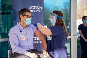 Dr. David Banach gets vaccinated for COVID-19 by staff nurse Jennifer Pickert on December 15, 2020.