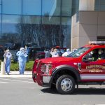 As the pandemic stretched on into summer, the renewed sense of gratitude so many felt toward health care workers led to parades held by UConn's Division of Public Safety in Farmington, here, and in Storrs Center, thanking medical providers for their near-superhuman resilience. (Tina Encarnacion/UConn Health photo)