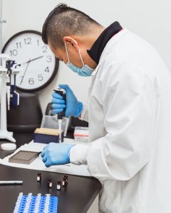 Microbiology technologist works with samples in lab