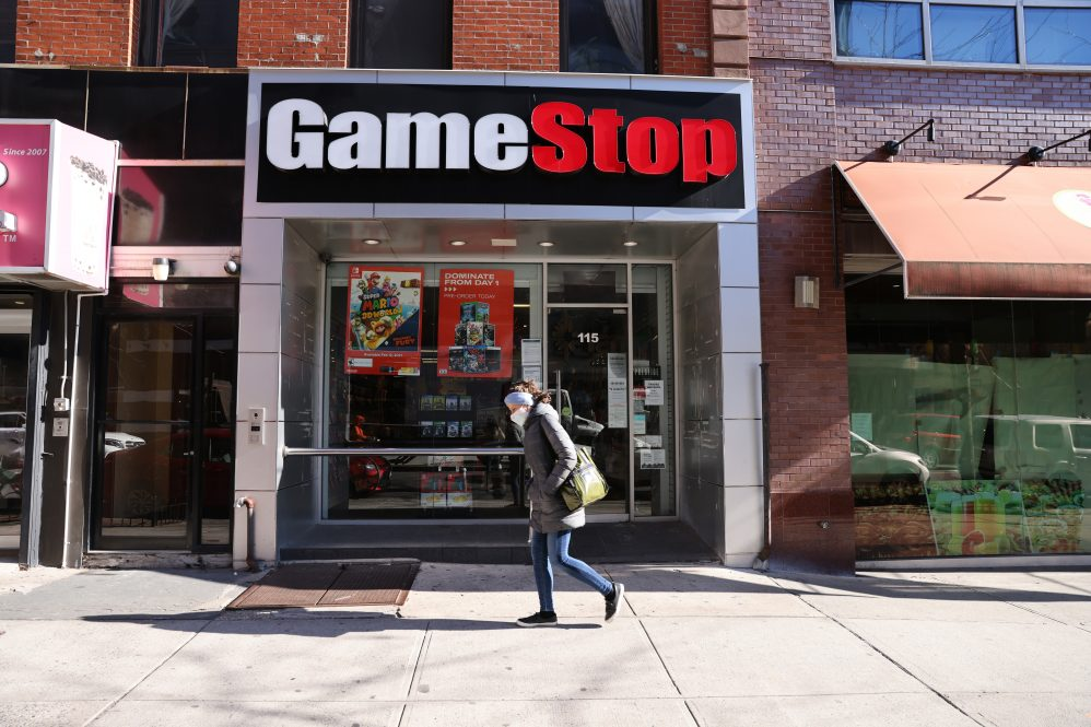 People walk by a GameStop store in Brooklyn on January 28, 2021 in New York City