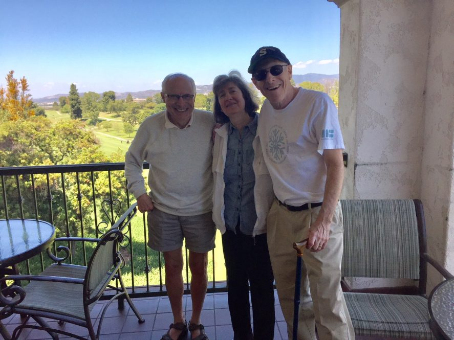 UConn Law Professor Lewis Kurlantzick, left, with Deborah Silberstein and Fred Cantor, both 1978 graduates of the law school, in California in 2018. Cantor's new book describes the lifelong New York Knicks obsession that he shares with Kurlantzick.