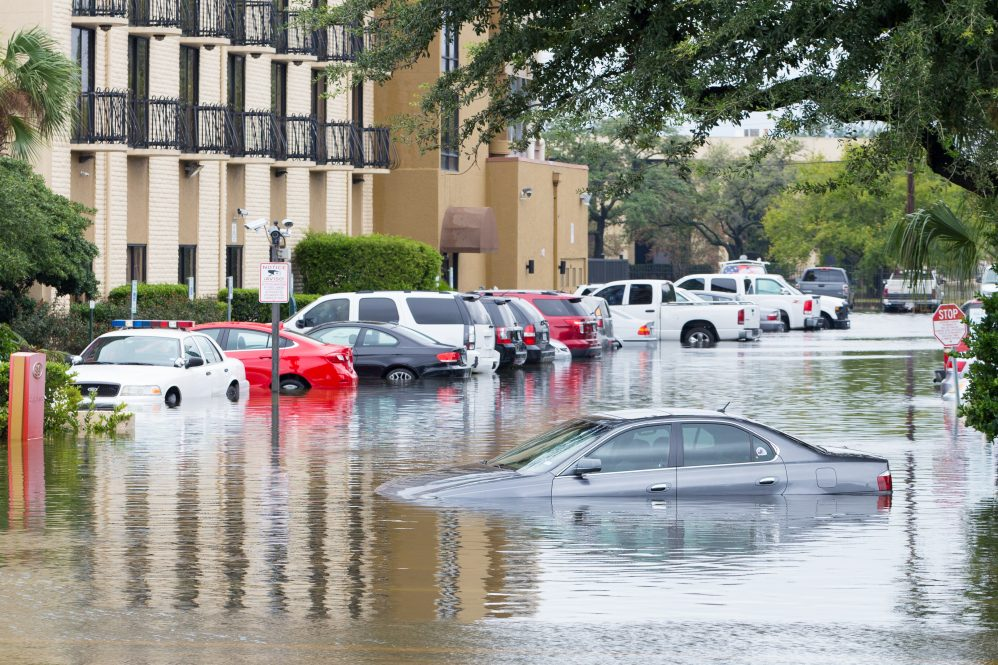 Cars submerged in Houston, Texas in the aftermath of Hurricane Harvey in 2017. A number of factors, including race, influence how different cities respond to flooding, according to new research.