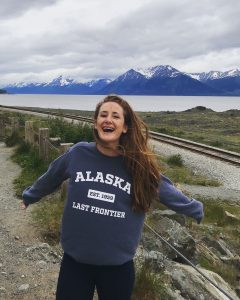 Alumna and documentary filmmaker Michelle Wax pictured outdoors in Alaska during the making of her documentary film about the nature of happiness.