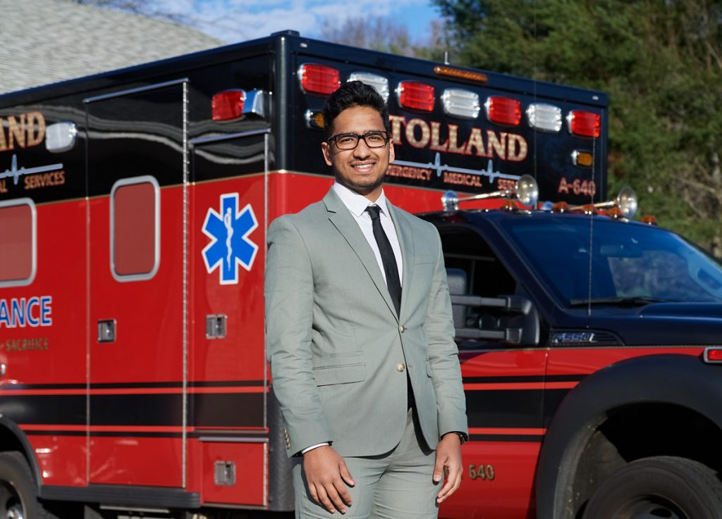 Vishal Patel standing in front of an ambulence