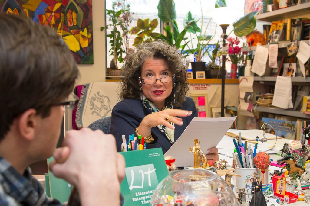 Gina Barreca at a table having a book discussion