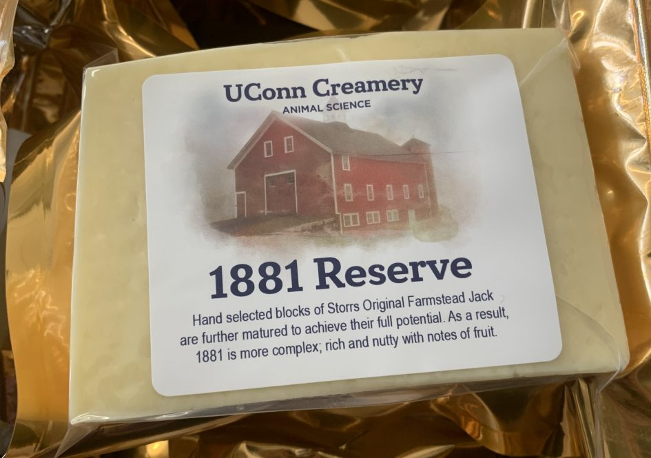 Close up of UConn Creamery's 1881 Reserve in gold packaging with image of Red Barn on label