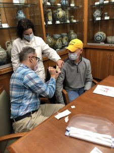 Jill Fitzgerald supervises two adult learners in proper immunization technique