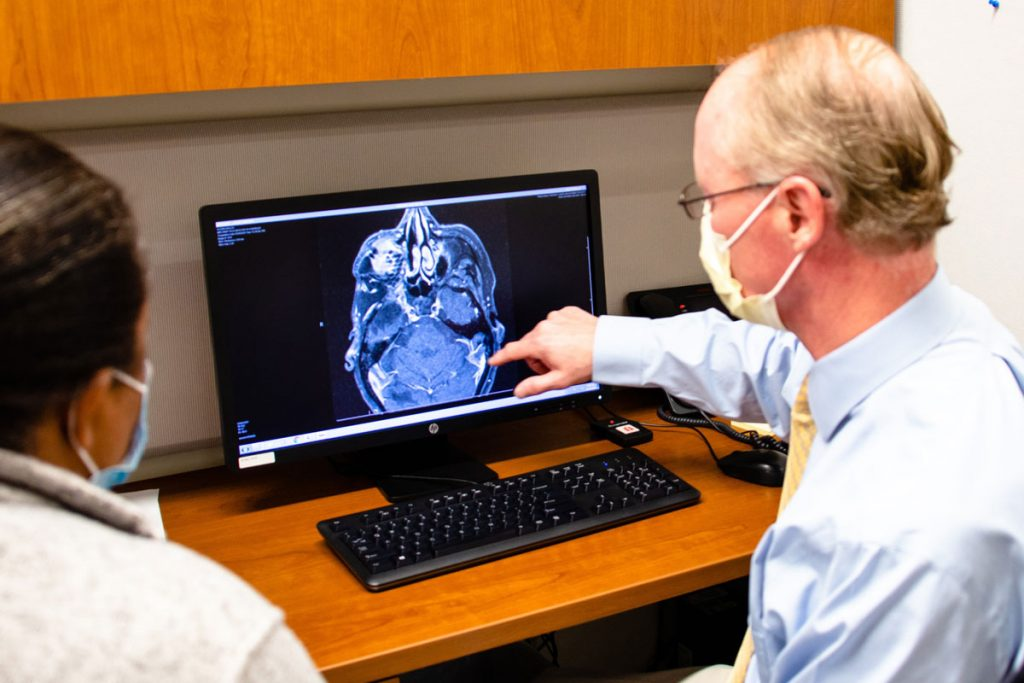 Dr. Keving Becker showing patient a brain image