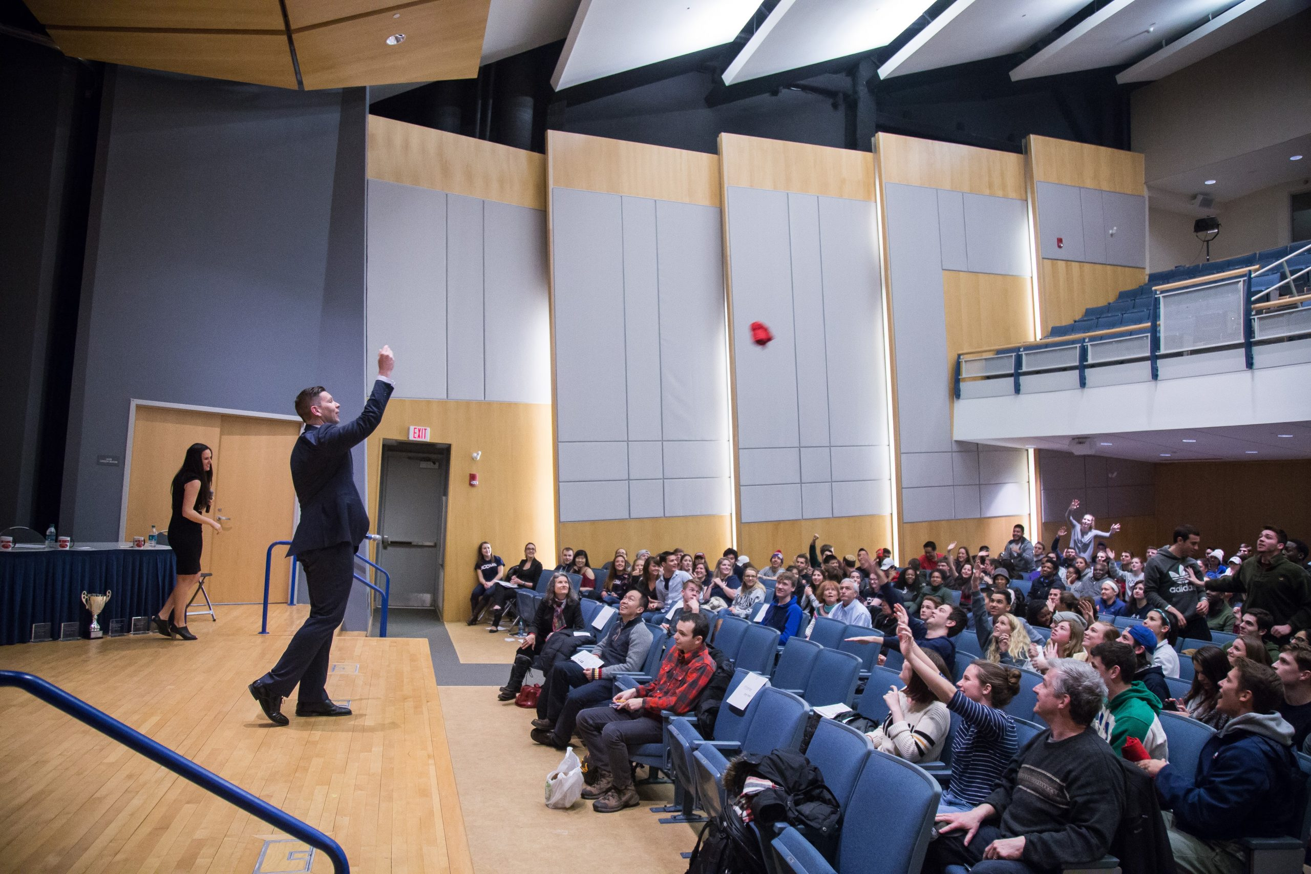 Rory McGloin, associate professor of communication, speaks on stage to an audience.