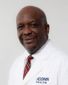 Dr. HIlary Onyiuke white coat portrait