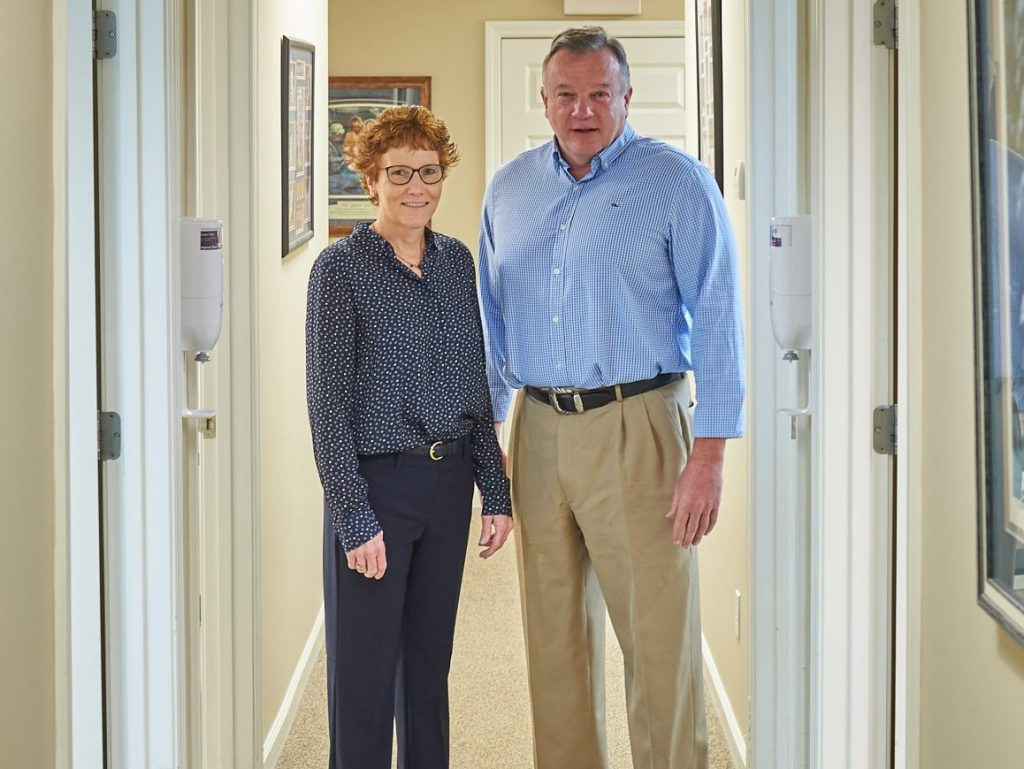 Drs. Karla and Michael Scanlon in their medical office