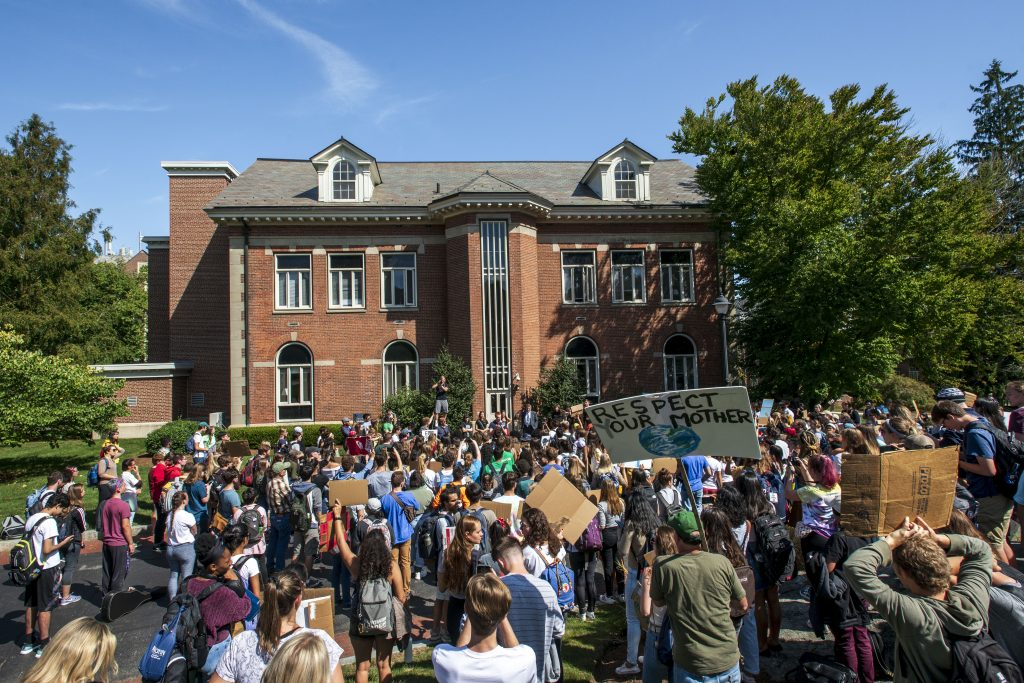 President Katsouleas talks with students about the Climate Strike outside Gulley Hall on Sept. 20, 2019. (Sean Flynn/UConn Photo)