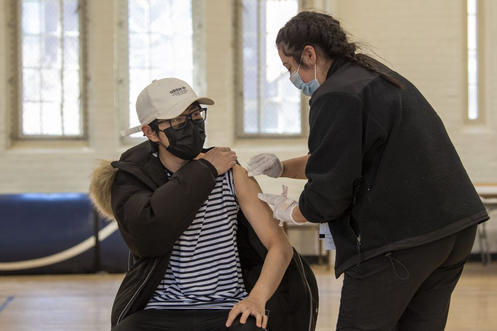 Students receiving the COVID 19 vaccine at Hawley Armory on April 8, 2021. (Sean Flynn/UConn Photo)