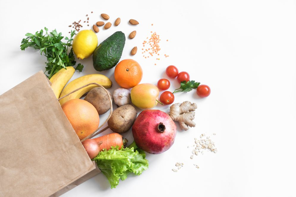 A grocery bag full of fruits and vegetables. Food pantry clients have said they want more healthy options, according to new research.