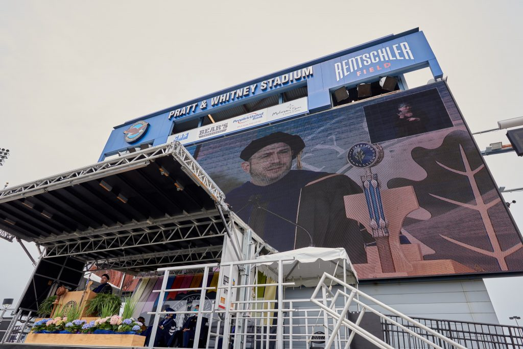 Provost Carl Lejuez is seen on the jumbotron while speaking during the Class of 2020 Commencement ceremony at Pratt & Whitney Stadium at Rentschler Field in East Hartford on May 8, 2021. (Peter Morenus/UConn Photo)