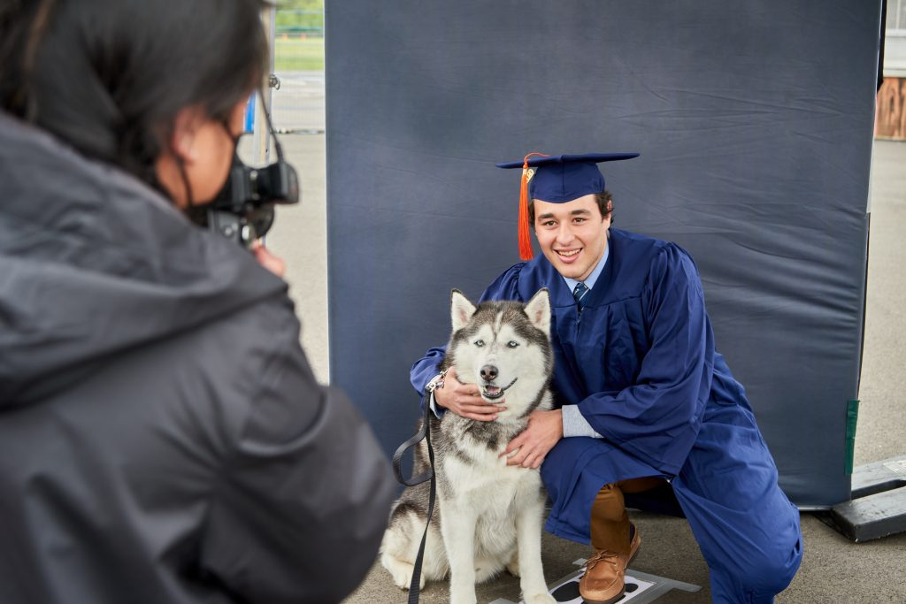 Christos Bagtzoglou '20 (ENG) poses for a portrait with Jonathan XIV during the Class of 2020 Commencement ceremony at Pratt & Whitney Stadium at Rentschler Field in East Hartford on May 10, 2021. (Peter Morenus/UConn Photo)