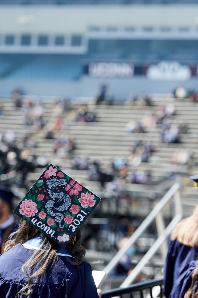 Degree candidates process toward the stage to be announced during the morning College of Liberal Arts and Sciences Commencement ceremony at Pratt & Whitney Stadium at Rentschler Field in East Hartford on May 9, 2021. (Peter Morenus/UConn Photo)