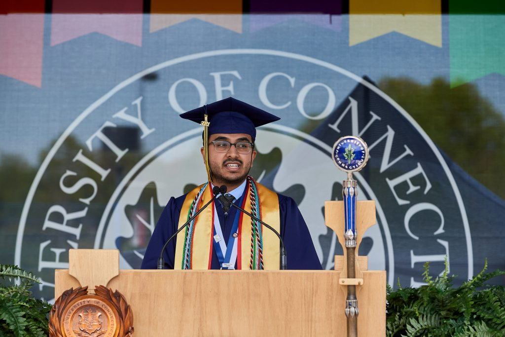 Parth Patel '21 (CLAS) gives the address during the morning College of Liberal Arts and Sciences Commencement ceremony at Pratt & Whitney Stadium at Rentschler Field in East Hartford on May 9, 2021. (Peter Morenus/UConn Photo)