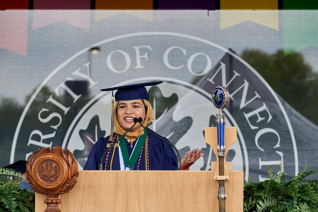 Fizza Alam '21 (CLAS) gives the student remarks during the afternoon College of Liberal Arts and Sciences Commencement ceremony at Pratt & Whitney Stadium at Rentschler Field in East Hartford on May 9, 2021. (Peter Morenus/UConn Photo)