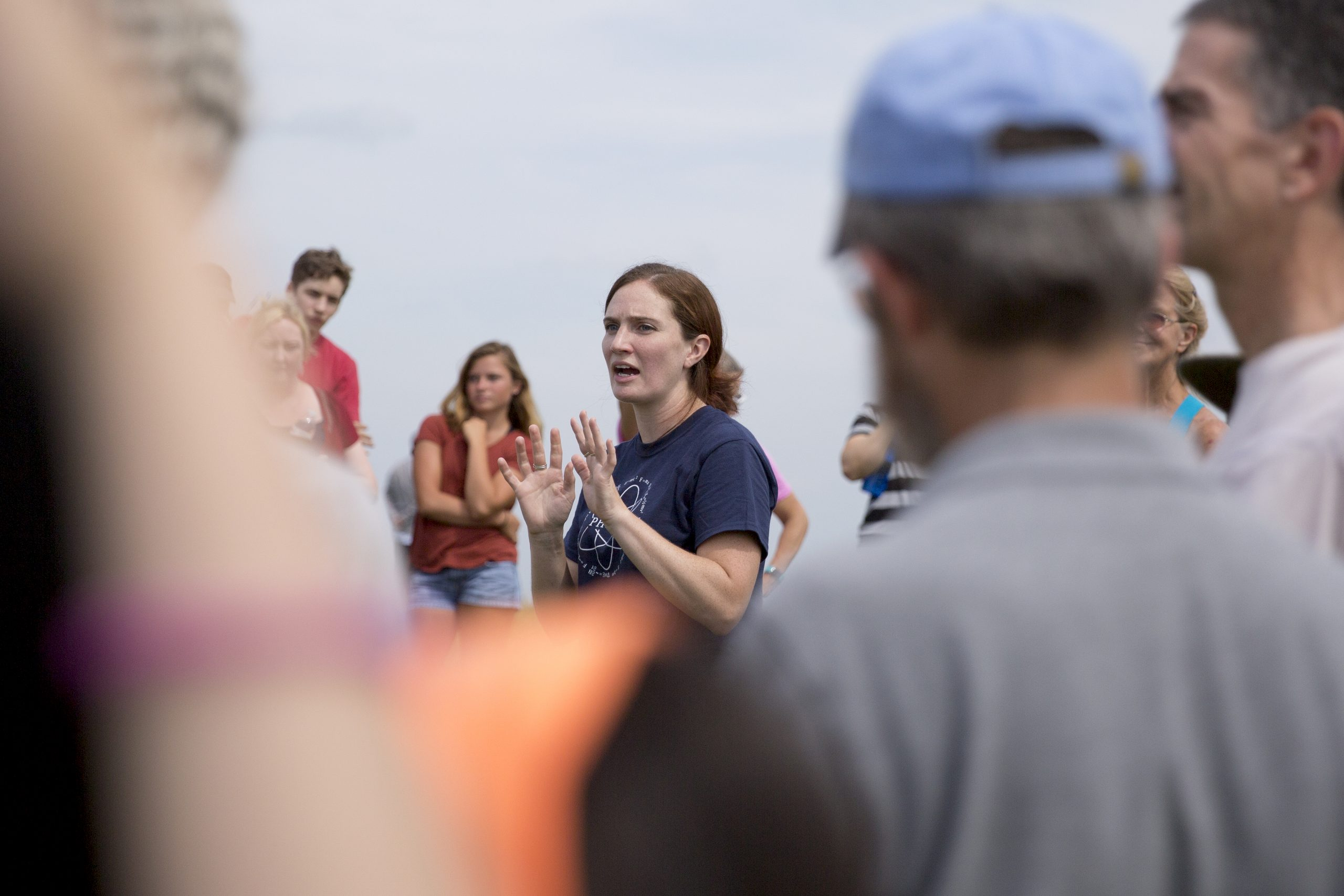 Associate Professor of Physics Cara Battersby talks to attendees at a solar eclipse viewing on Horsebarn Hill in 2017. Her work uses high-performance computing to understand astronomical questions