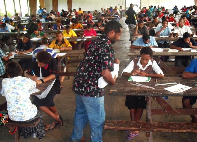 Secondary school students in PNG being tested on their language skills.