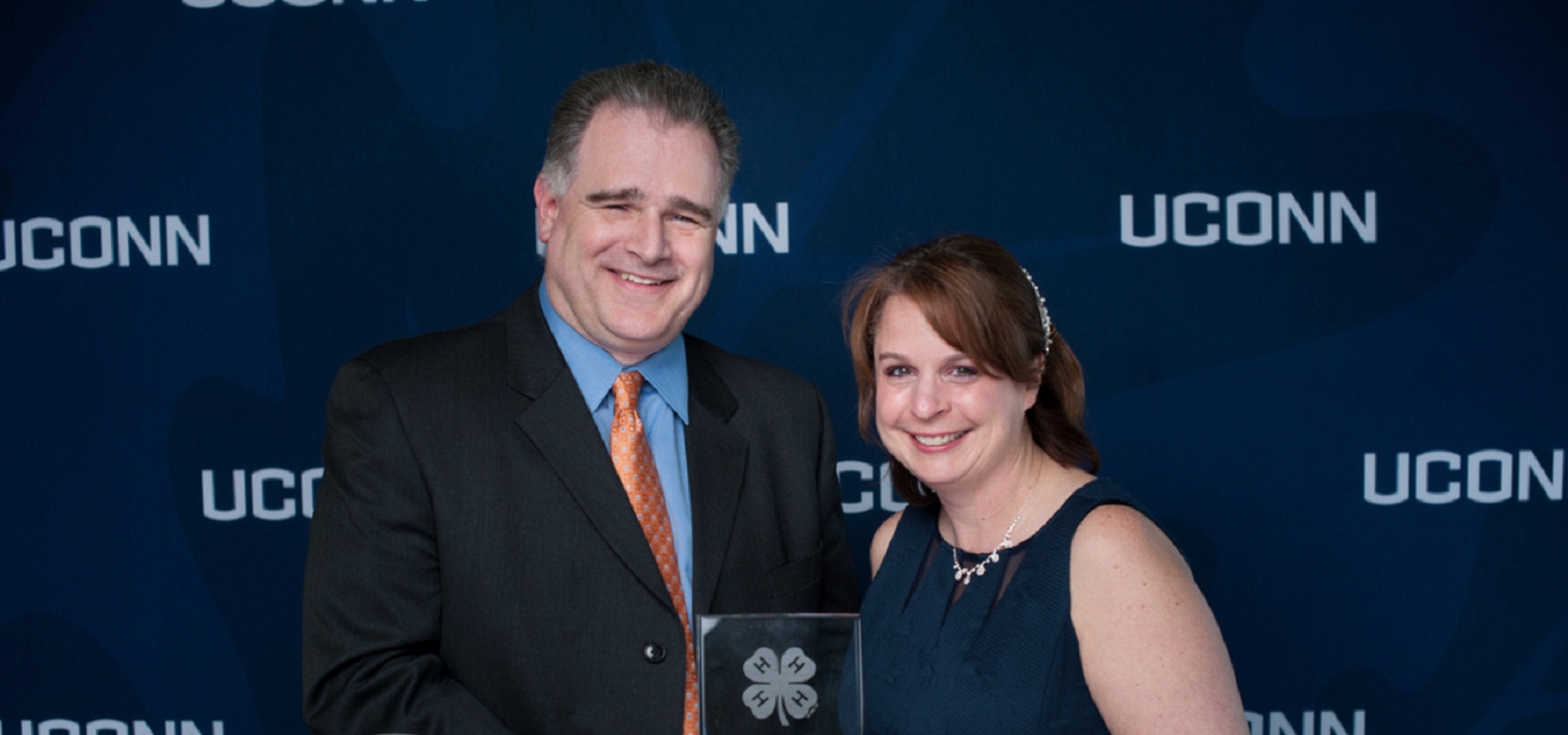 Rachael Manzer, with her husband Ken, receives a 4-H leadership award in 2019. Manzer, a STEM educator who has worked with NASA, is a doctoral candidate in the Neag School of Education. (Courtesy of Defining Studios)