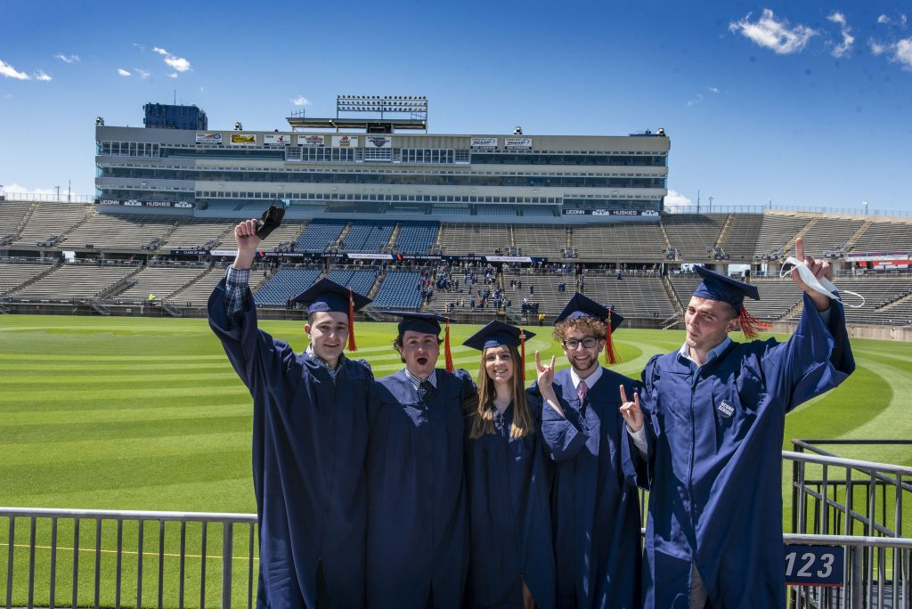 From right Michael Allen '21 (ENG), Jack Aaron 21 (ENG), Carla Patania '21 (ENG), Seth Fortin '21 (ENG), and Ryan Stachelczyk (ENG) at the 2021 School of Engineering Commencement ceremony at Pratt & Whitney, Rentschler Field on May 11, 2021. (UConn photo/Sean Flynn)
