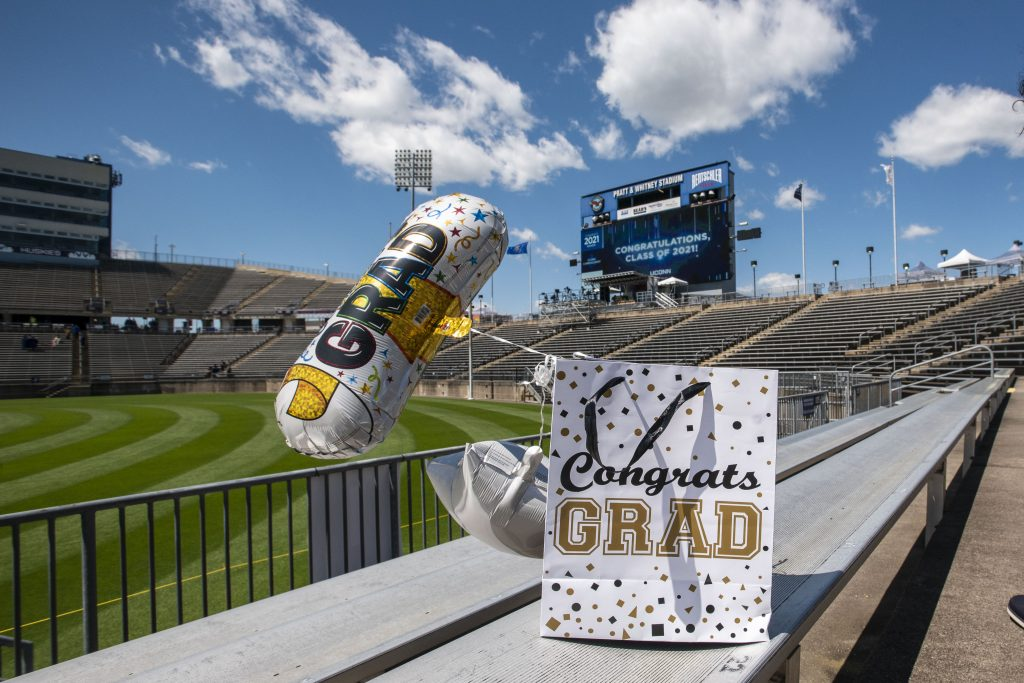 Party balloons and Congrats Grad bag at the 2021 School of Engineering Commencement ceremony at Pratt & Whitney, Rentschler Field on May 11, 2021. (UConn photo/Sean Flynn)