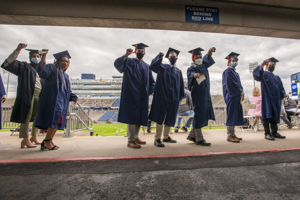 From left 2020 engineering students San Khan, Gail Mitchell, Joshua Dupont, Caleb Nuhn, Leopoldo Moore, and John Mayer at the 2020 Commencement ceremony at Pratt & Whitney Stadium, Rentschler Field on May 10, 2021. (UConn photo/Sean Flynn)
