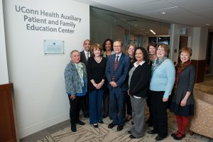 Group photo in front of UConn Health Auxiliary Patient and Family Education Center