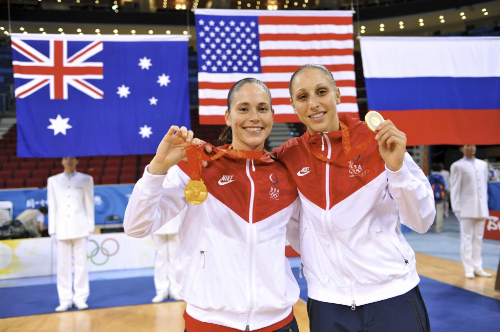 UConn alumnae Sue Bird (left) and Diana Taurasi, shown here with the gold medals they won at the Beijing 2008 Olympic Games, will again represent the USA in the summer games, this year in Tokyo.
