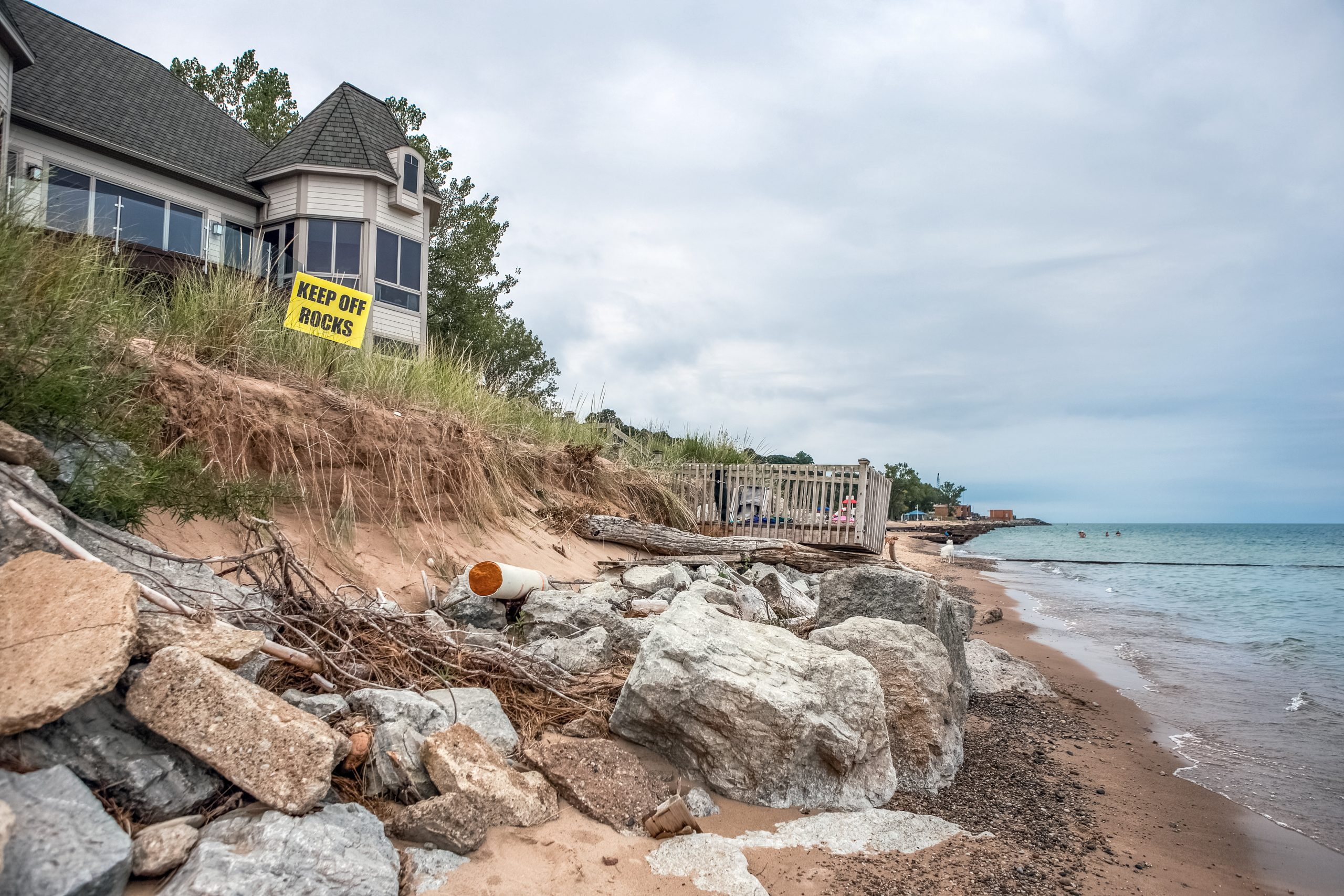Beach houses on Lake Michigan, lake erosion dangerously close to houses, half the beach is gone due to high water