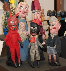 Punch and Judy hand puppets created by Fred Kneeland in the 1920s includes a Black minstrel figure, reflecting the immense popularity of minstrel shows.