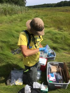 Aiden Barry '19 (CAHNR) sampling soil for microbial analysis in the field.