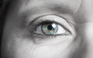 A closeup photograph in black and white of a woman's right eye, by photographer Joe Standart.